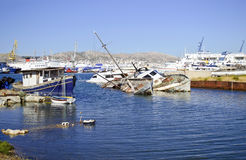 Sunk boats in industrial area of Salamis Greece stock photography