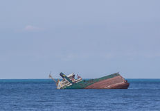 Sunk ship in blue water Stock Photo