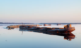 Sunken barges. Rusty barges have been left in the sea to act as breakwater in Oulu, Finland Stock Images