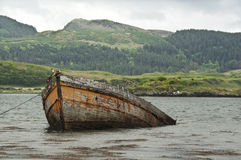 Sunken Boat. Part Sunken Boat close to shore Royalty Free Stock Images