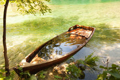 Sunken boat in autumn lake Royalty Free Stock Photos
