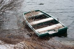 Sunken boat. On Cerknica lake in winter Stock Photo