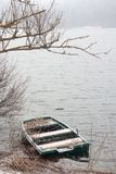 Sunken boat. On Cerknica lake in winter Stock Photos