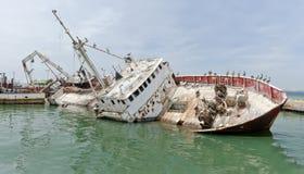 Sunken boat at the dock Stock Photo