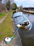 Sunken boat. Moored sunken wooden canal boat in Cheshire UK Royalty Free Stock Photo