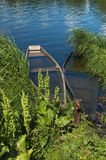 Sunken boat on the river in the green vegetation Royalty Free Stock Images