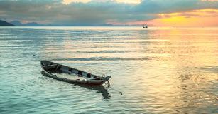 Sunken boat at sea. Small fishing boat filled with water after a rainstorm Stock Photos