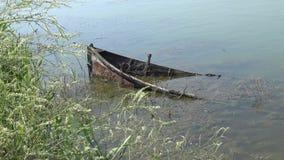 Sunken boat at the shore in Sasyk lake. Ukraine stock video footage