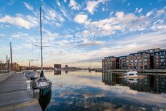 Sunken boat and Union Wharf, in Baltimore, Maryland.  stock photo