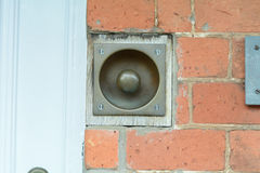 Sunken brass doorbell Royalty Free Stock Images