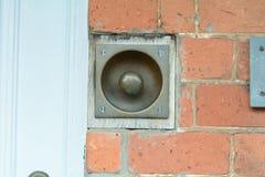 Sunken brass doorbell Royalty Free Stock Images
