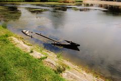 Sunken Canoe. An old boat in the water Stock Image