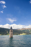 Sunken church tower in lake in the alps Stock Photography