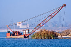 Sunken excavator. In the river Olt Royalty Free Stock Photos