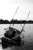 Sunken Fishing Boat. Black and white picture of a sunken fishing boat listing badly Royalty Free Stock Photos