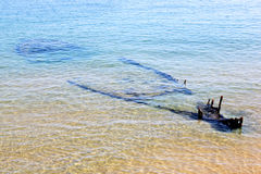 Sunken fishing boat in Adriatic Sea, Vieste, Italy. Vieste is a small fishing town along the Adriatic Sea in the Apulia (Puglia) region of Italy, located on the Royalty Free Stock Images