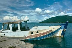 A sunken fishing boat in the port Stock Image
