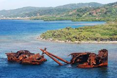 Sunken in Honduras. The sunken rusty ship near Roatan island (Honduras Royalty Free Stock Images