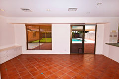 Sunken Lounge Room. A sunken lounge room with views of the pool and gardens Stock Photo