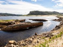 Sunken old wooden fishing boats in Teriberka, Murmansk Oblast, Russia stock images