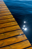 Sunken pier on a summer day. Play of light on top of a pier which has been submerged by a flooding lake Stock Photos