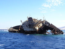 Sunken ship. Dangerous dark blue sea, broke against corals, ship-wreck, cemetery of the s in a red sea, on a day marine Royalty Free Stock Photography
