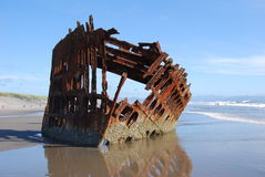 Sunken Ship. A sunken ship on the beach Stock Photo