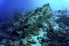 Sunken ship with  diver Stock Images