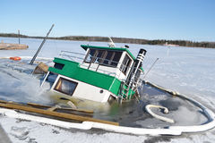 Sunken ship in the Lappeenranta harbor at winter. Stock Photos