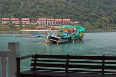 Sunken ship near pier of Bang Bao fishing village, which consists of houses on stilts built into the sea. Royalty Free Stock Photography