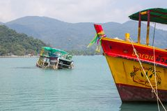 Sunken ship near pier of Bang Bao fishing village, which consists of houses on stilts built into the sea. Stock Images