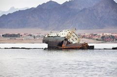Sunken ship opposite the island of Tiran in the Red Sea in Egypt. The ship, castaway in the Red Sea at coast of the island the Tyrant in 1982 Royalty Free Stock Photo