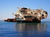 A sunken ship in the shallows. Red sea, Egypt. The reefs of Tiran. Diving holiday ship reef tiran summer Royalty Free Stock Image