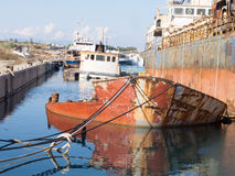 Sunken Ship wreck in a dock Royalty Free Stock Photos