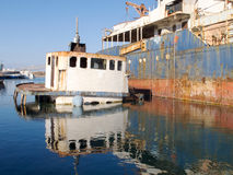 Sunken Ship wreck in a dock Stock Images