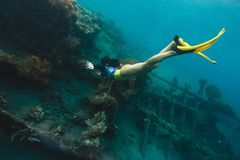 A sunken shipwreck in the mediterranean sea with a scuba diver stock images