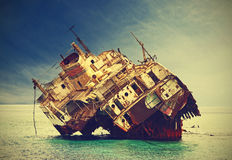 The sunken shipwreck on the reef, Egypt, vintage effect. Royalty Free Stock Photography