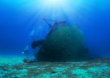 A sunken shipwreck with a scuba diver stock photo
