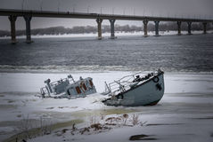 Sunken vessel in a frozen river Stock Photos