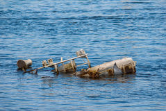 Sunken vessel in a river Royalty Free Stock Photography