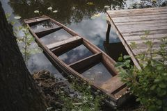 A sunken wooden boat at the pier stock image