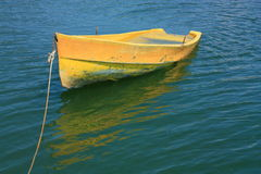 Sunken yellow Boat. A damaged yellow boat with water inside Stock Photos