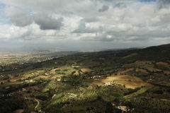 Sunkissed Italian Countryside. Image on a cloudy day of sun dancing over the Italian hills of Assisi Stock Photography