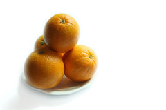 Sunkist orange in white plate Stock Photography