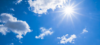 Sunlight. Blue sky with the sun and clouds Stock Photography