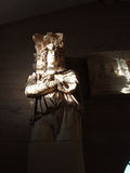 Sunlight on ancient statue. A view of sunlight shining brightly on an ancient statue in a museum in Corinth, Greece Stock Photo