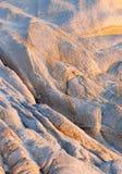 Sunlight on beach rocks royalty free stock photos