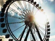 Oktoberfest Ferris Wheel. Sunlight beaming through the spokes of the Oktoberfest Ferris Wheel Royalty Free Stock Photos