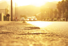 Sunlight from behind mountains at sunset time on the roadside in Italy. Royalty Free Stock Images