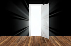 Sunlight behind the opening door Royalty Free Stock Photography
